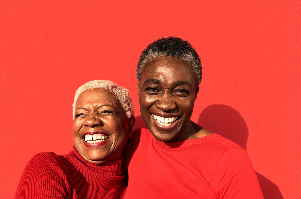 Two older women smiling