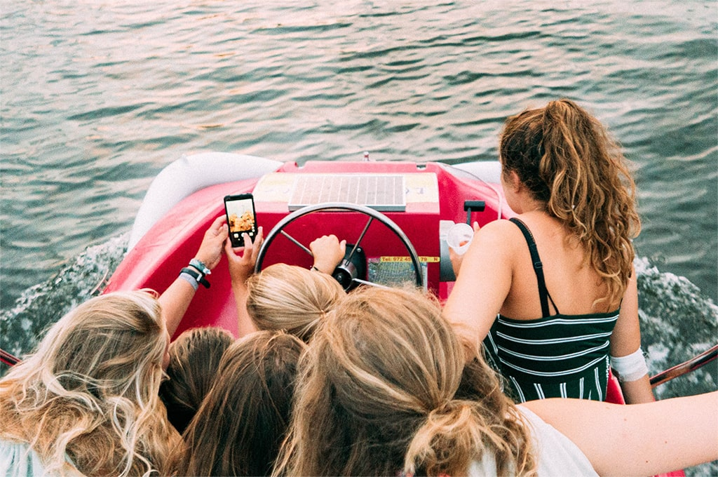 Teenagers taking a selfie during a day out