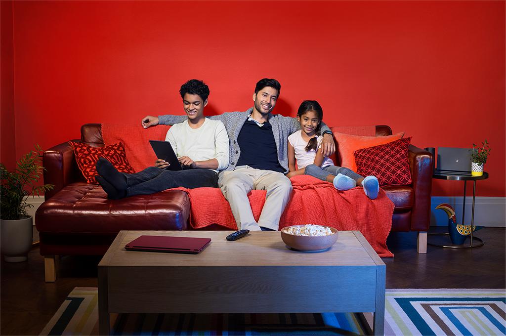 Family on sofa using iPad