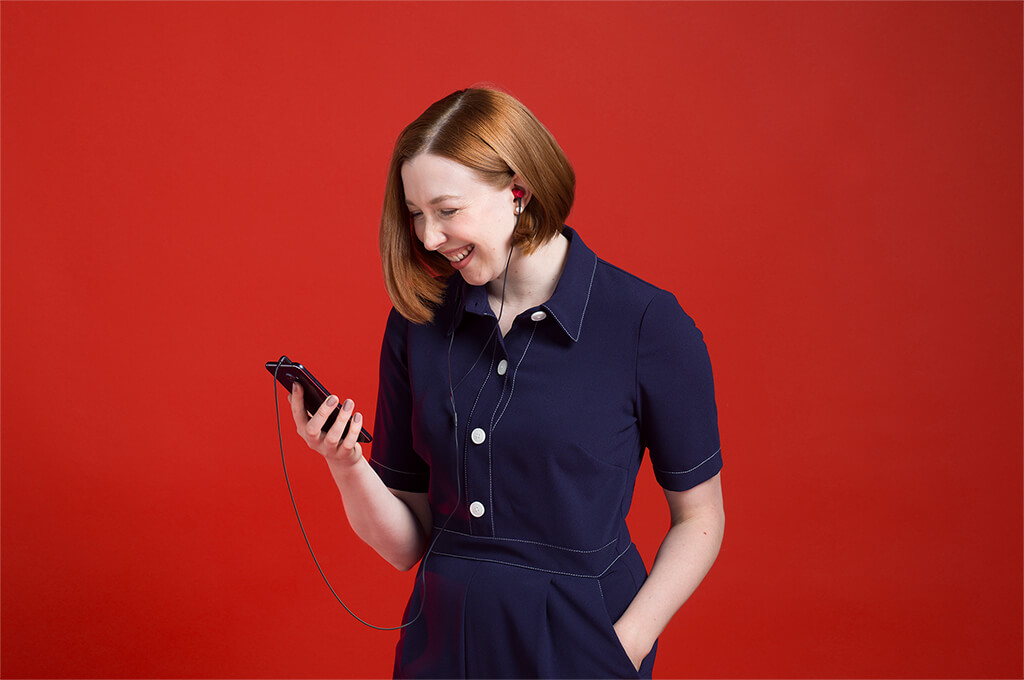 Woman watching a film on a phablet