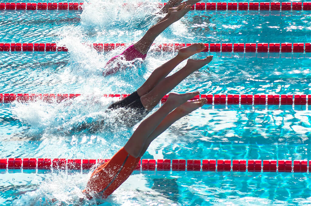 Swimmers racing in a pool