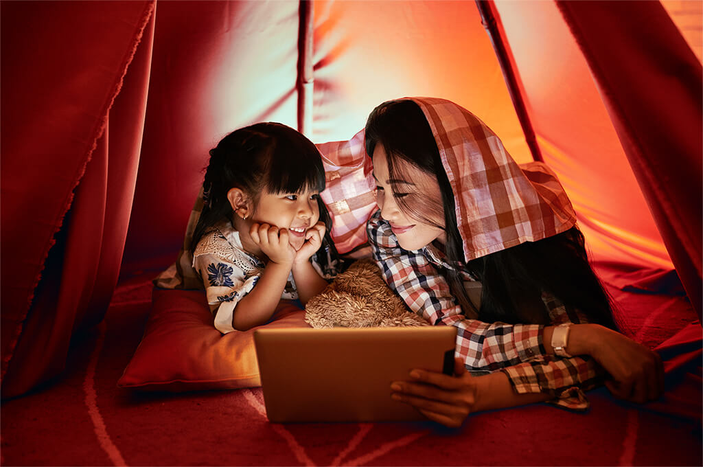 Family in play tent